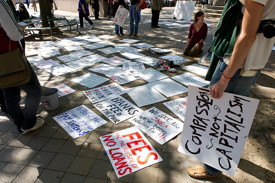 Signs concerning a variety of issues from the ongoing wars in Afghanistan and Iraq to corporate greed and jobs are layed out at Freedom Plaza as hundreds of protesters gather before marching to the White House, Chamber of Commerce and along K Street in NW Washington, DC, October 6,  2011. (Andrew Harnik / The Washington Times)