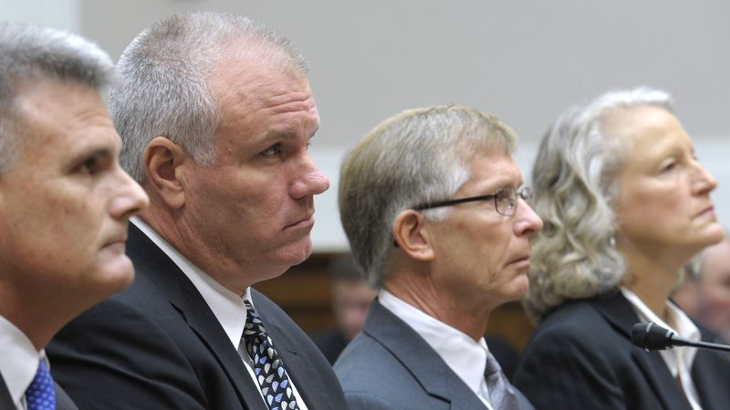 From left: Attorney Walter Brown, Solyndra CEO Brian Harrison, Chief Financial Officer Bill Stover, and attorney Jan Nielsen Little are seen on Capitol Hill on Sept. 23, 2011, prior to Harrison and Stover testifying before the House Oversight and Investigations subcommittee. (Associated Press)