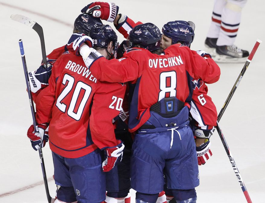 Washington Capitals' Troy Brouwer (20), Alex Ovechkin (8), and Dennis Wideman (6) celebrate a goal earlier this preseason. (AP Photo/Charles Dharapak)