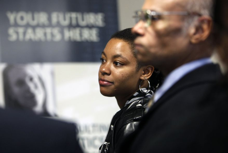 Janae Taylor (left), of Boston, waits in line to speak with a participating employer Oct. 7, 2011, during a jobs fair sponsored by U.S. Sen. Scott Brown, Massachusetts Republican, at Roxbury Community College in Boston. (Associated Press)