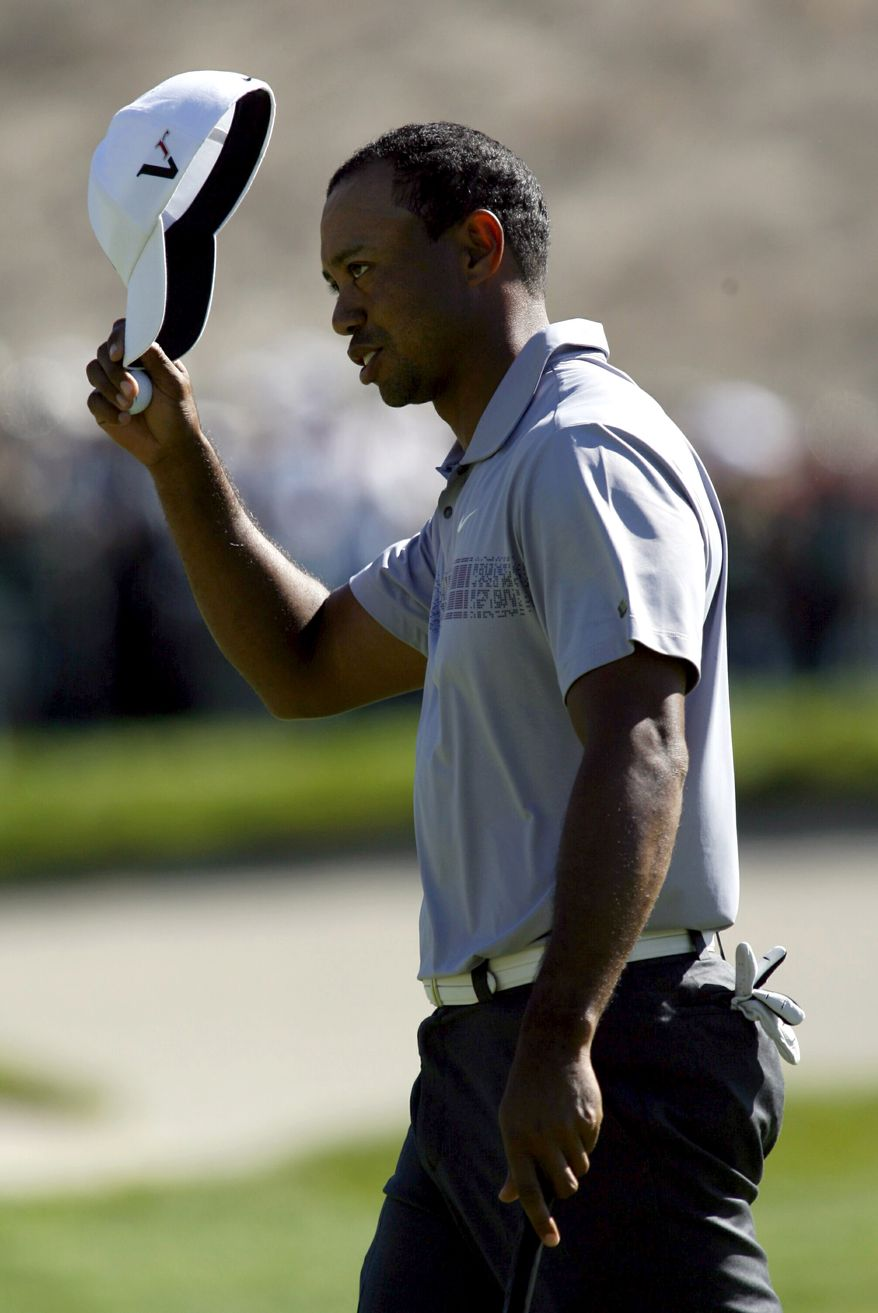 Tiger Woods finishes his round at the ninth hole during the second round of the Frys.Com Open golf tournament, Friday, Oct. 7, 2011, in San Martin, Calif. (AP Photo/Dino Vournas)