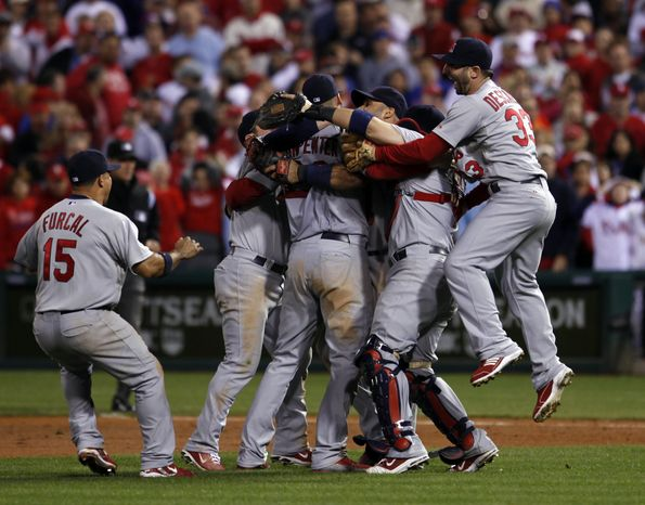 The St. Louis Cardinals react after winning with a score of 1-0, baseball's Game 5 of the National League division series with the Philadelphia Phillies Friday, Oct. 7, 2011 in Philadelphia. (AP Photo/Alex Brandon)