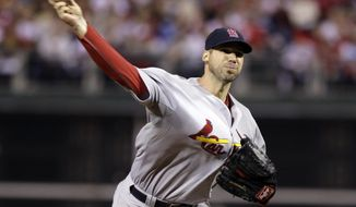 St. Louis Cardinals starting pitcher Chris Carpenter throws a pitch during the second inning of baseball's Game 5 of the National League division series with the Philadelphia Phillies Friday, Oct. 7, 2011 in Philadelphia. (AP Photo/Matt Slocum)