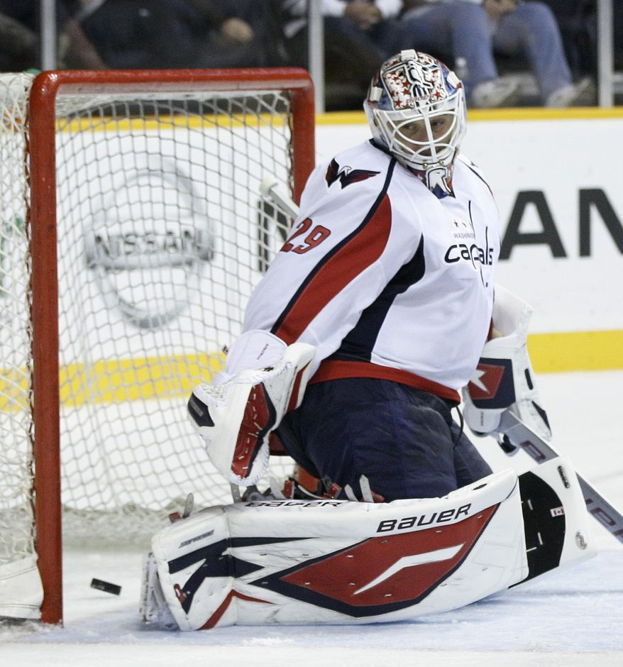 ** FILE ** Washington Capitals goalie Tomas Vokoun (29) looks back as a shot by Nashville Predators forward Matt Halischuk gets past for a goal in the second period of a preseason NHL hockey game on Wednesday, Sept. 28, 2011, in Nashville, Tenn. (AP Photo/Mark Humphrey)