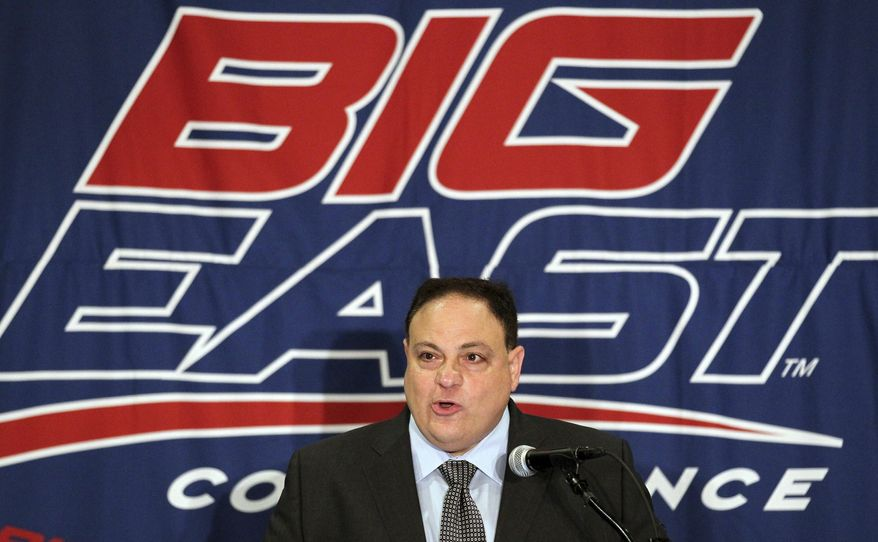 FILE - In this Aug. 2, 2011, file photo, Big East commissioner John Marinatto speaks to reporters during Big East NCAA college football media day in Newport, R.I. Big East football school officials will meet Tuesday night in New York City to discuss the league's future, and a Pac-12 official expects conference presidents in that league to decide by the end of the week if they want to expand again. (AP Photo/Stew Milne, File)