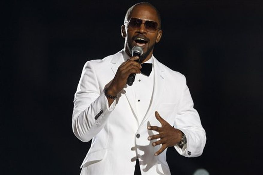 US actor and singer Jamie Foxx performs at the Michael Forever the Tribute Concert, at the Millennium Stadium in Cardiff, Saturday, Oct. 8, 2011. (AP Photo/Joel Ryan)