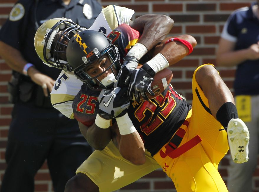 Maryland defensive back Dexter McDougle (25) intercepts a pass intended for Georgia Tech wide receiver Stephen Hill (5) during the second quarter of an NCAA college football game, Saturday, Oct, 8, 2011 in Atlanta . (AP Photo/John Bazemore)