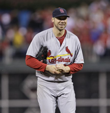St. Louis Cardinals starting pitcher Chris Carpenter smiles after getting Philadelphia Phillies' Ryan Howard out on a fly to right field during the seventh inning of Game 5 of the NLCS on Friday, Oct. 7, 2011 in Philadelphia. The Cardinals won 1-0. (AP Photo/Matt Slocum)