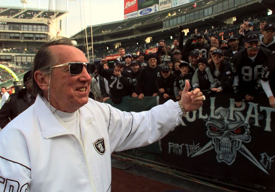FILE - In this Dec. 26, 1998 file photo, Oakland Raiders owner Al Davis gives a thumbs-up to fans prior to the game with the Kansas City Chiefs, in Oakland, Calif. The Oakland Raiders announce Saturday, Oct. 8, 2011, that longtime owner and Hall of Famer Davis has died. He was 82. (AP Photo/Paul Sakuma, File)