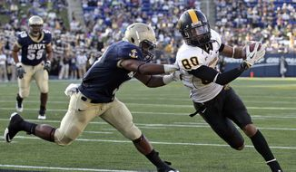 Southern Miss wide receiver Ryan Balentine, runs past Navy safety Tra'ves Bush for a touchdown in the first half of an NCAA college football game in Annapolis, Md., Saturday, Oct. 8, 2011. (AP Photo/Patrick Semansky)