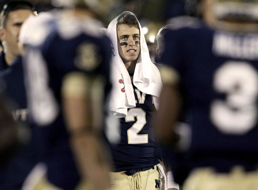 Navy quarterback Kriss Proctor looks on from the sideline during the second half of an NCAA college football game against Southern Miss in Annapolis, Md., Saturday, Oct. 8, 2011. Proctor was pulled from the game in the fourth quarter. Southern Miss won 63-35. (AP Photo/Patrick Semansky)