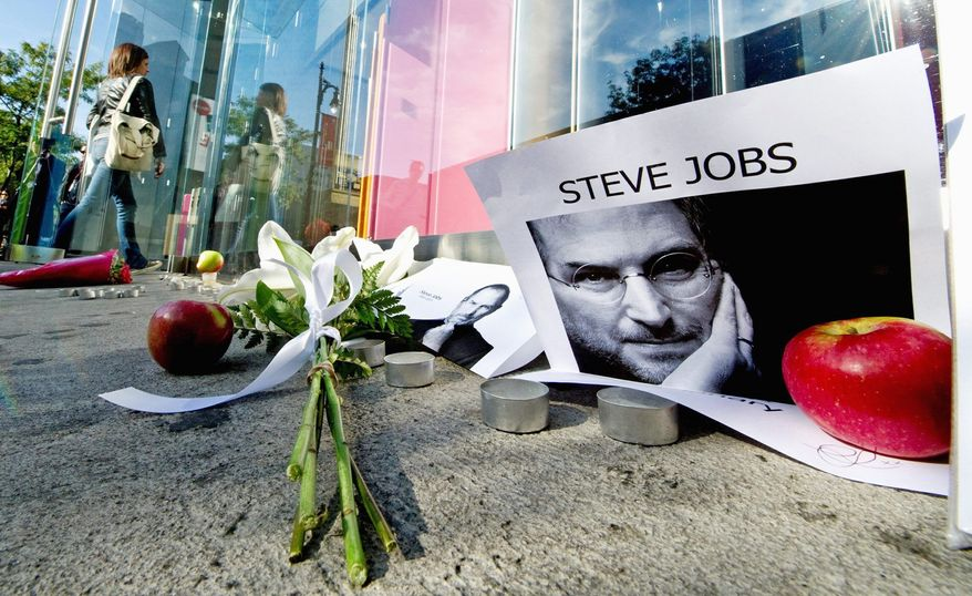 A memorial outside an Apple Store in Montreal honors Steve Jobs, the Apple co-founder who died Wednesday. (Canadian Press via Associated Press)