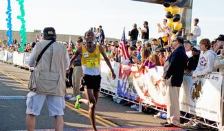 Tesfaye Sendeku, 26, of Ethiopia finishes in first place at the 27th Army Ten-Miler race at the Pentagon in Washington, D.C. on Sunday, October 9, 2011. (Pratik Shah/The Washington Times)