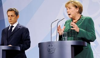 ** FILE ** German Chancellor Angela Merkel (right) and French President Nicolas Sarkozy discuss the European financial crisis on Sunday, Oct. 9, 2011, in Berlin. (Associated Press)