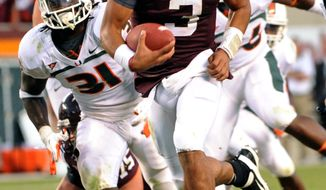 Virginia Tech quarterback Logan Thomas (3) runs ahead of Miami's Sean Spence (31) for the game-winning touchdown during the second half of an NCAA college football game Saturday, Oct. 8, 2011, in Blacksburg, Va. Virginia Tech defeated Miami 38-35. (AP Photo/Don Petersen)