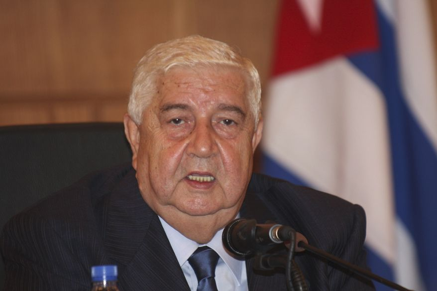 Syrian Foreign Minister Walid al-Moallem speaks during a joint press conference with his Venezuelan and Cuban counterpats in Damascus, Syria, on Sunday, Oct. 9, 2011. (AP Photo/Bassem Tellawi)