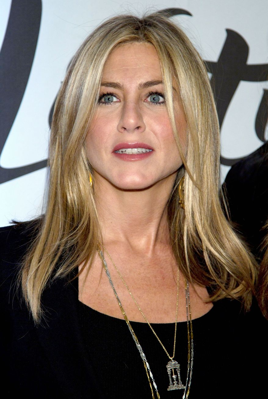 Jennifer Aniston said she threw a chair at a director because of the way he treated a script supervisor. (Associated Press)