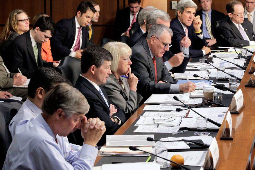 ** FILE ** The Joint Select Committee on Deficit Reduction meets on Capitol Hill last month. Supercommittee members (from left) are Rep. Fred Upton, Rep. Xavier Becerra, Rep. Jeb Hensarling, Sen. Patty Murray, Sen. Jon Kyl, Sen. Max Baucus, Sen. Rob Portman, Sen. John F. Kerry and Sen. Patrick J. Toomey. (Associated Press)