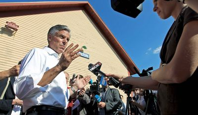 "Former Utah Gov. Jon Huntsman Jr. talks to reporters after a town-hall meeting Monday in Tilton, N.H. ""Simply advocating more ships, more troops and more weapons is not a viable path forward,"" he said in a swipe at Mitt Romney, who has called for military increases. (Associated Press)"