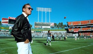 "Raiders owner Al Davis (seen here), who died Saturday, carried on a long feud with Mike Shanahan, a former Raiders coach. But Shanahan, now with the Redskins, said, ""I never met a guy that had more passion and worked harder than Al Davis."" (Associated Press)"