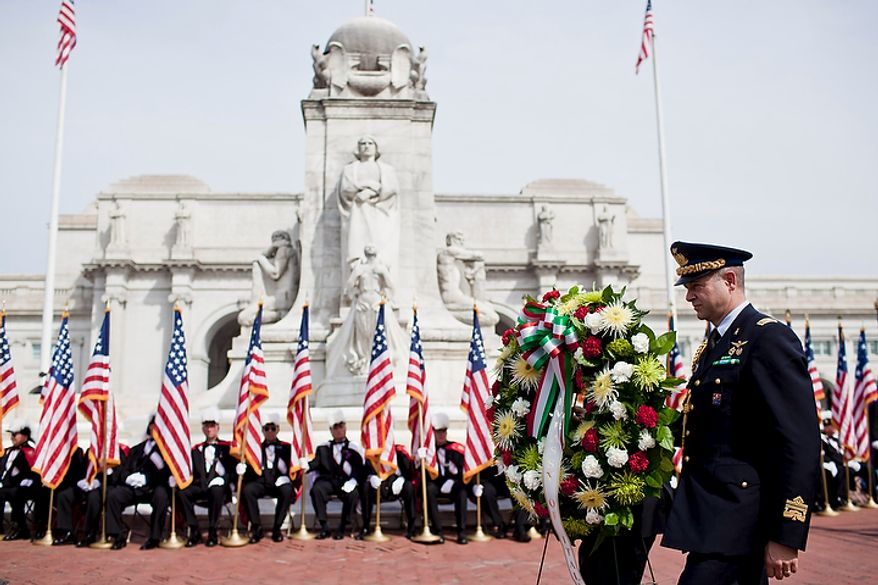 Representatives from the Italian Embassy present a wreath before the Columbus Memorial statue during a Columbus Day celebration and wreath presentation at Union Station in Washington on Monday, Oct. 10, 2011. (T.J. Kirkpatrick/The Washington Times)