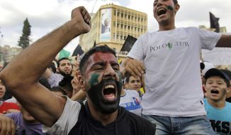 Protesters shout slogans against Syrian President Bashar Assad's regime after prayers in Tripoli, Lebanon, on Friday, Oct, 7, 2011. (AP Photo/Bilal Hussein)