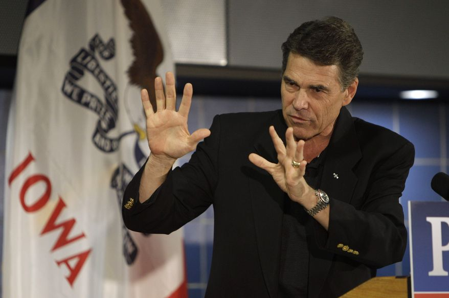 Texas Gov. Rick Perry speaks Oct. 7, 2011, during the Johnson County GOP Fall BBQ at Clear Creek-Amana High School in Tiffin, Iowa. (Associated Press)
