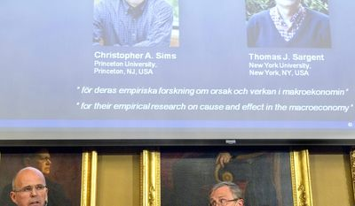 Per Krusell (left) and Staffan Normark of the Royal Swedish Academy of Sciences announce during a press conference in Stockholm on Monday, Oct. 10, 2011, that Americans Thomas Sargent (top right) and Christopher Sims (top left) have won the 2011 Nobel Memorial Prize in Economic Sciences. (AP Photo/Fredrik Sandberg/ SCANPIX)
