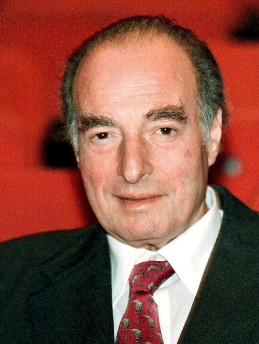 Attorney General Eric H. Holder Jr. was deputy attorney general when President Bill Clinton pardoned fugitive financier Marc Rich (shown here), but Mr. Holder's depiction of his involvement has been questioned. (Associated Press)