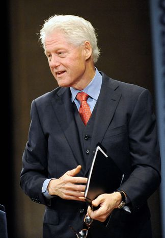Attorney General Eric H. Holder Jr. was deputy attorney general when President Bill Clinton (shown here) pardoned fugitive financier Marc Rich, but Mr. Holder's depiction of his involvement has been questioned. (Associated Press)