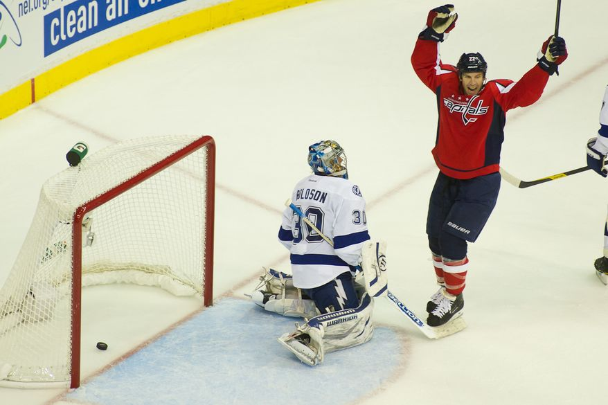 Mike Knuble (22) celebrates as Jason Chimera (25) of the Washington Capitals scores on goalie Dwayne Roloson (30) of the Tampa Bay Lightning to tie the game 5-5 in the third period at the Verizon Center in Washington, D.C., Oct. 10, 2011. (Andrew Harnik/The Washington Times)