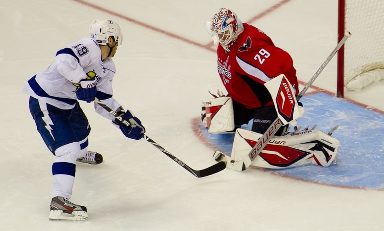 Goalie Tomas Vokoun (29) of the Washington Capitals blocks Dominic Moore (19) of the Tampa Bay Lightning during a shootout at the Verizon Center in Washington, D.C., Oct. 10, 2011. (Andrew Harnik/The Washington Times)