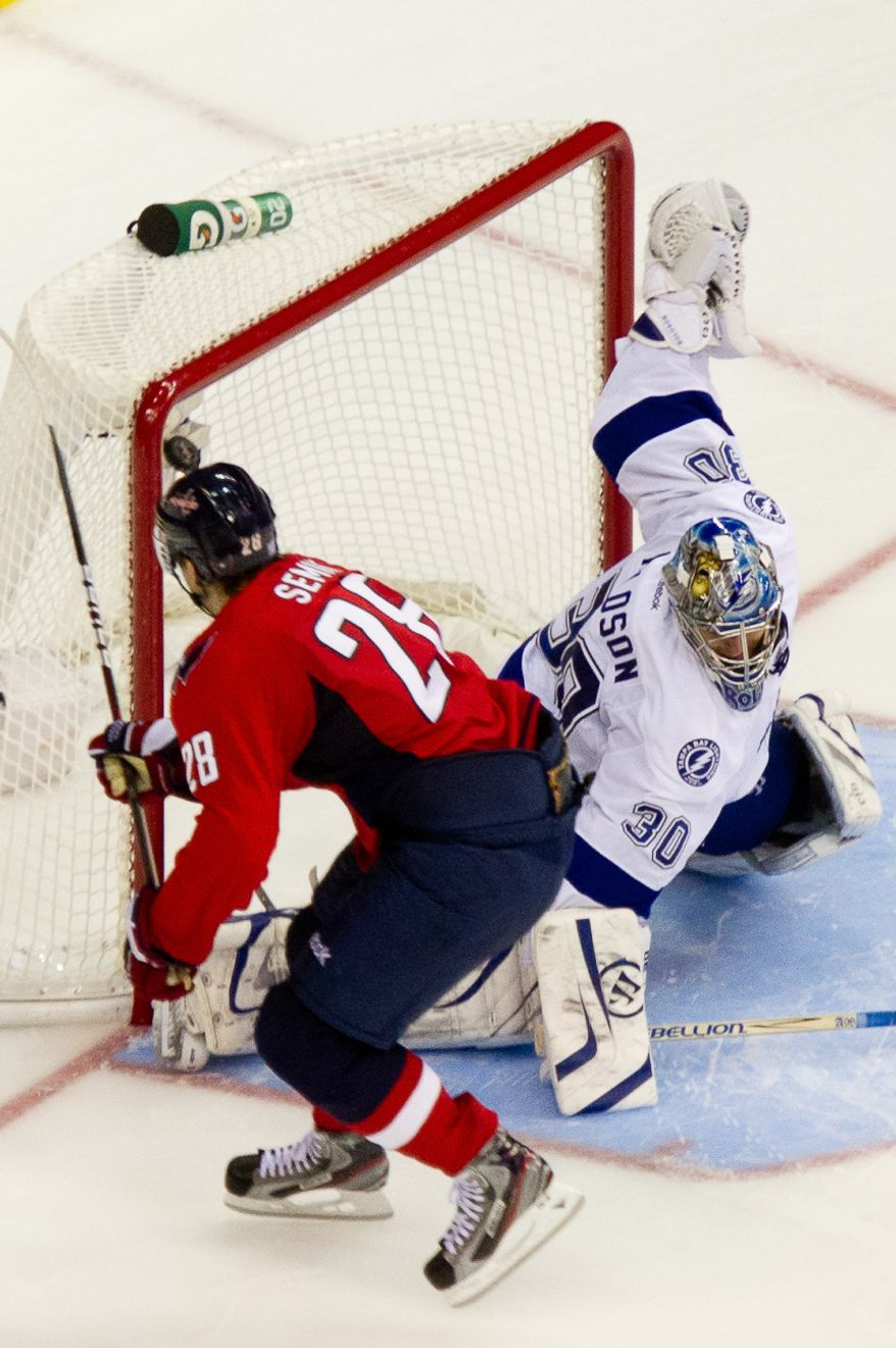 Alexander Semin (28) of the Washington Capitals makes the second shot during a shootout to win the game against goalie Dwayne Roloson (30) of the Tampa Bay Lightning at the Verizon Center in Washington, D.C., Oct. 10, 2011. (Andrew Harnik/The Washington Times)