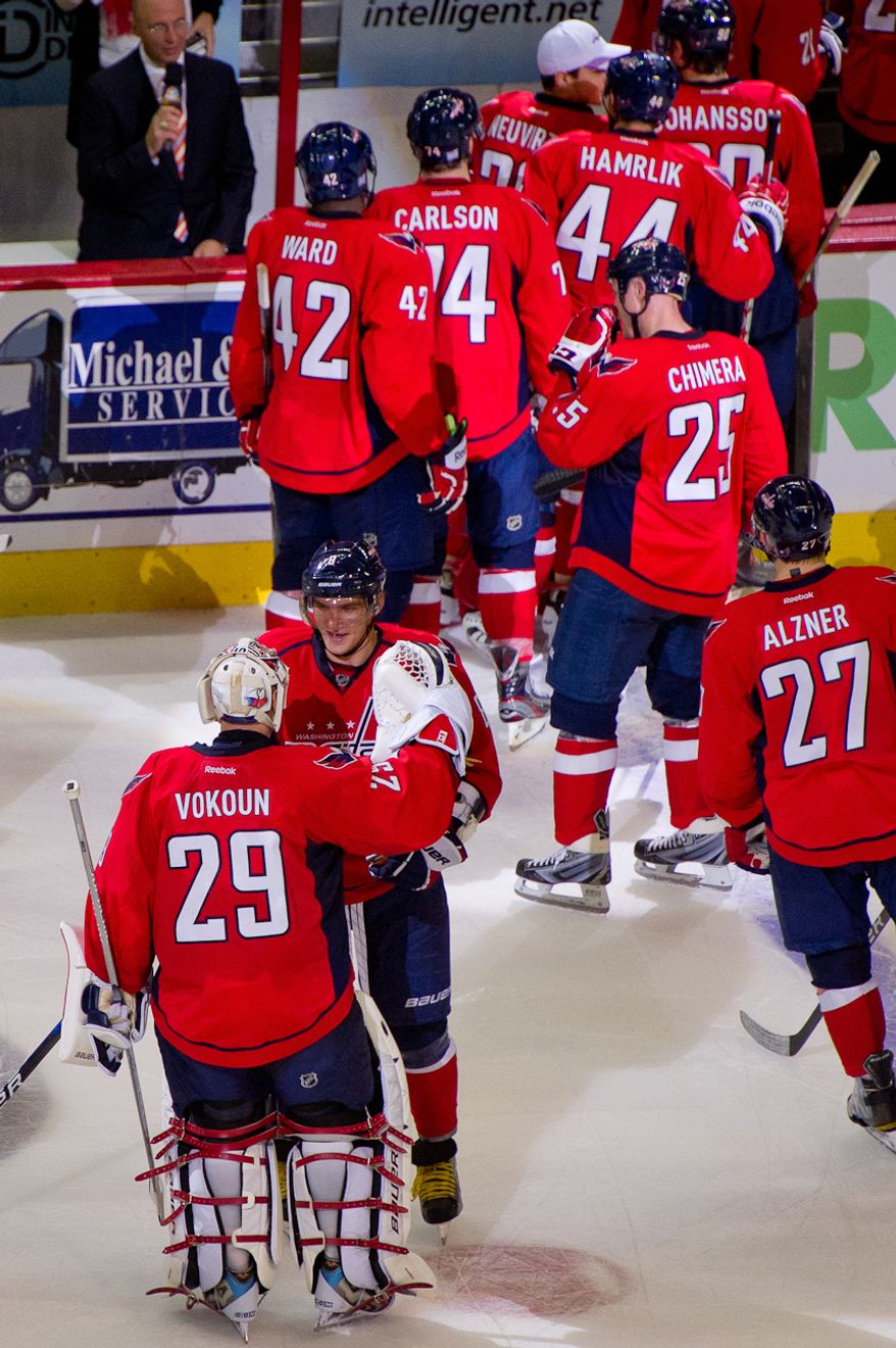 Goalie Tomas Vokoun (29) and Alex Ovechkin (8) of the Washington Capitals celebrate after a shootout to defeat the Tampa Bay Lightning at the Verizon Center in Washington, D.C., Oct. 10, 2011. (Andrew Harnik/The Washington Times)