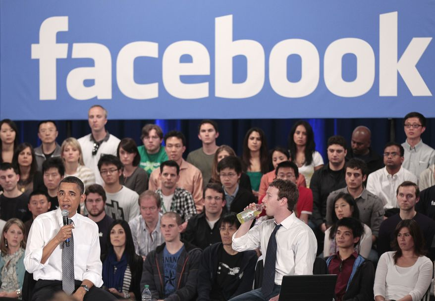 ** FILE ** In this April 20, 2011, file photo, President Barack Obama, accompanied by Facebook CEO Mark Zuckerberg, speaks during a town hall meeting to discuss reducing the national debt at Facebook headquarters in Palo Alto, Calif. (AP Photo/Pablo Martinez Monsivais)