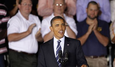 President Obama is applauded as he arrives at the International Brotherhood of Electrical Workers (IBEW) Local No. 5 Training Center in Pittsburgh on Oct. 11, 2011. (Associated Press)