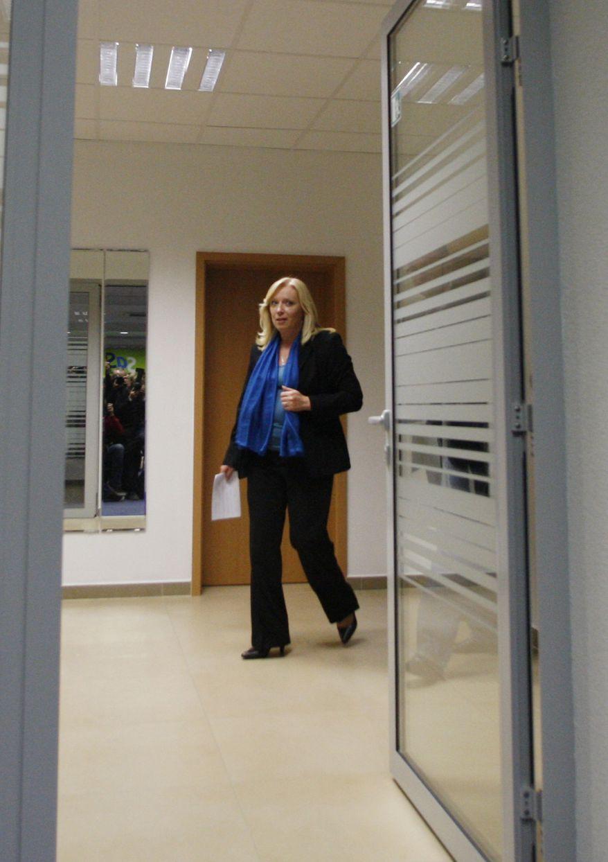 Slovakian Prime Minister Iveta Radicova heads to a press conference after a governmental coalition meeting in Bratislava, Slovakia, on Monday, Oct. 10, 2011. (AP Photo/Petr David Josek)