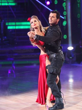 """Singer Chynna Phillips and her professional partner, Tony Dovolani, perform Monday on """"Dancing With the Stars."""" Miss Phillips """"blanked"""" on part of the routine, and the pair were eliminated. """"I messed up,"""" Miss Phillips said. (ABC via Associated Press)"""