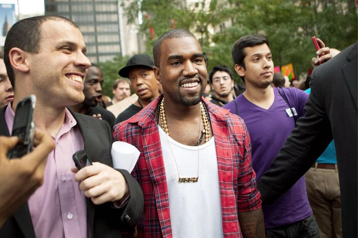 "Rapper Kanye West mixes in with the ""Occupy Wall Street"" protests in New York's Zuccotti Park. (Associated Press)"