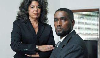 Albert Florence of New Jersey, here with his attorney, Susan Chana Lask, has a case before the U.S. Supreme Court about being strip-searched in two county jails, possibly violating his constitutional right of privacy. (Associated Press)