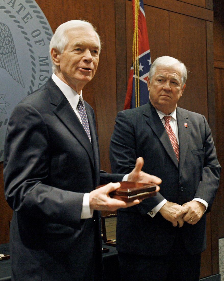 ** FILE ** Sen. Thad Cochran (left), Mississippi Republican, is pictured with then-Mississippi Gov. Haley Barbour, a fellow GOP member, in 2011. (Associated Press)