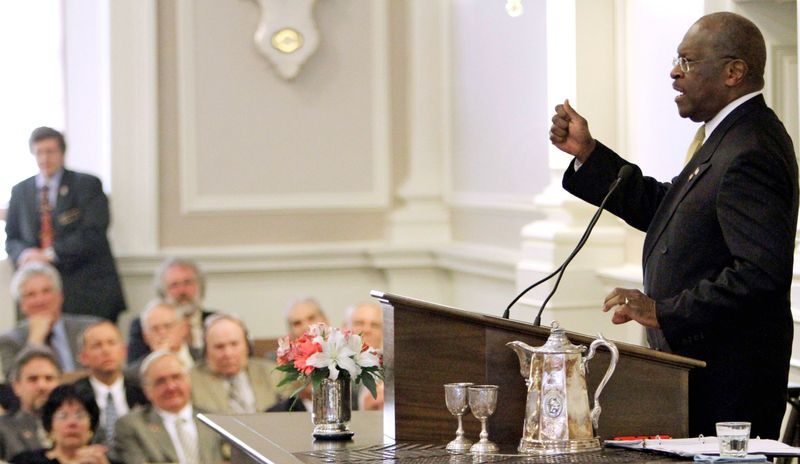 Republican presidential candidate Herman Cain addresses New Hampshire state lawmakers at the Statehouse in Concord, N.H., on Wednesday. Mr. Cain is surging in Republican presidential-preference polls. (Associated Press)