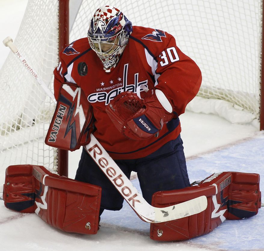 """Washington Capitals goalkeeper Michal Neuvirth is day to day with a """"lower-body injury"""" and his status for Thursday's game against the Pittsburgh Penguins is in doubt. (AP Photo/Luis M. Alvarez)"""