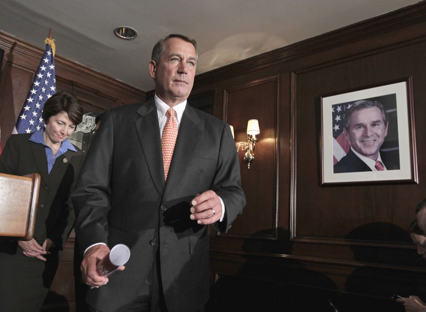 House Speaker John A. Boehner, accompanied by Rep. Cathy McMorris Rodgers, finishes a news conference on Capitol Hill in Washington on Wednesday, Oct. 12, 2011. (AP Photo/J. Scott Applewhite)