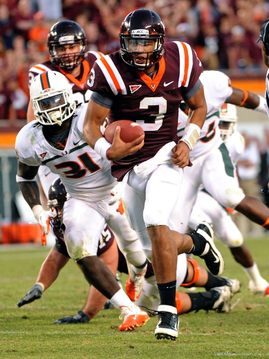 Virginia Tech sophomore quarterback Logan Thomas passed for 310 yards and three touchdowns and also rushed for two scores Saturday in a 38-35 victory over Miami. (Associated Press)
