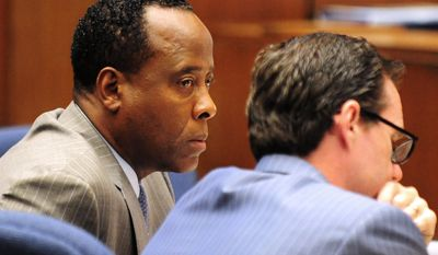 Dr. Conrad Murray listens in court Oct. 11, 2011, during his involuntary manslaughter trial in Los Angeles. Murray has pleaded not guilty and faces four years in prison and the loss of his medical license if convicted of involuntary manslaughter in Michael Jackson's death. (Associated Press)