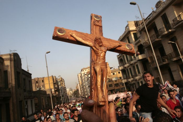 Egyptian Christians protest outside St. Mark's Cathedral in Cairo against the country's military ruling council on Monday, Oct. 10, 2011. (AP Photo/Amr Nabil)