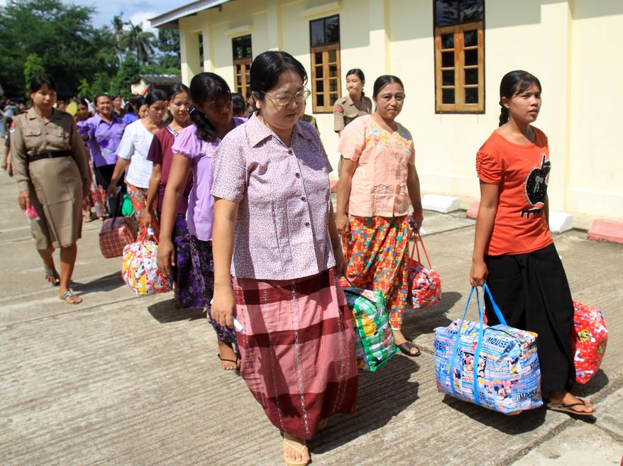 Female prisoners leave Insein Prison in Yangon, Myanmar, on Wednesday, Oct. 12, 2011, after they were released in an amnesty by Myanmar President Thein Sein. (AP Photo/Khin Maung Win)