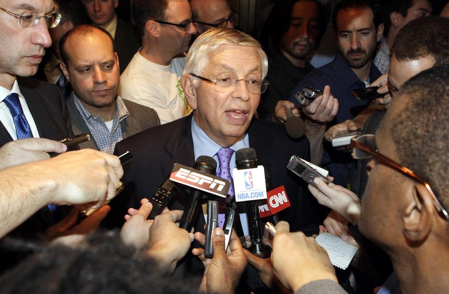 NBA Commissioner David Stern (center) talks Oct. 10, 2011, with reporters after leaving an NBA labor talks meeting in New York. Stern canceled the first two weeks of the season after players and owners were unable to reach a new labor deal to end the lockout. At left is Deputy Commissioner Adam Silver. Opening night was scheduled for Nov. 1. (Associated Press)