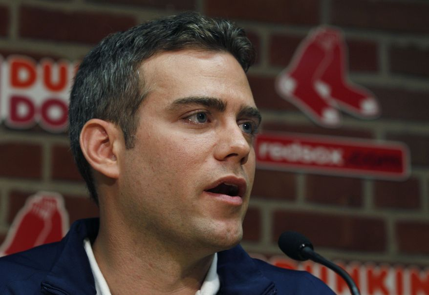 Former Red Sox general manager Theo Epstein has agreed to a five-year deal with the Chicago Cubs. (AP Photo/Elise Amendola)